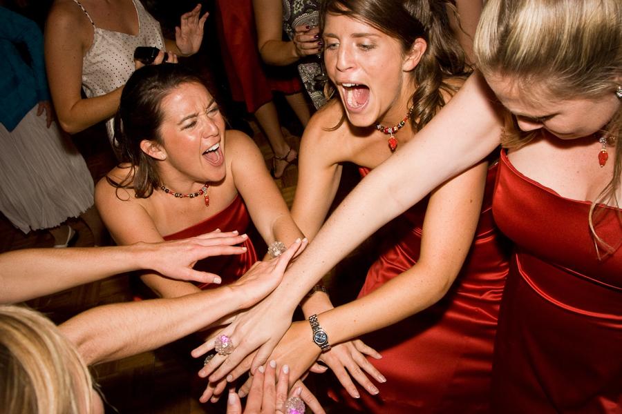 dancing red bridesmaids